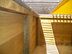 Retaining all should be well built, and the frame should sit on top of retaining wall.