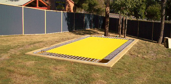why have an in ground trampoline topline trampolines. Black Bedroom Furniture Sets. Home Design Ideas